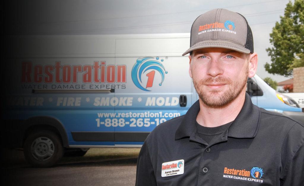 Restoration franchise restoration 1 technician in front of truck