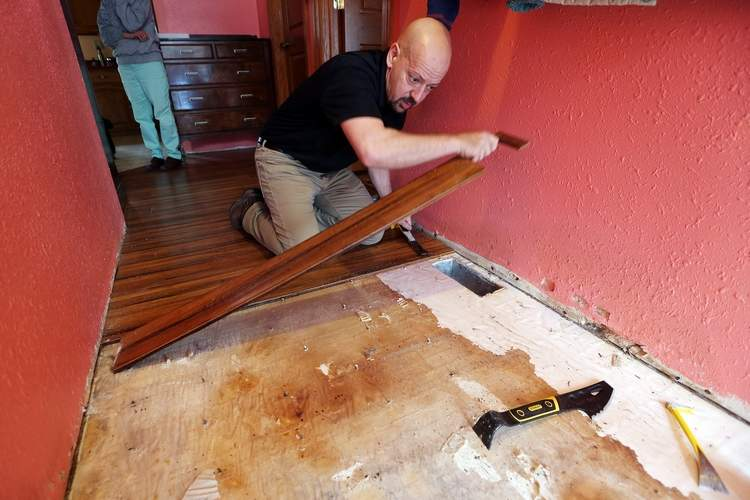 Restoration 1 man removing flooring